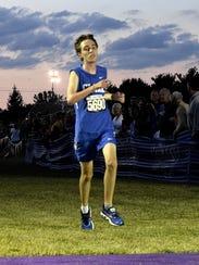 Ryan Estes of Clark Montessori finishes first in the