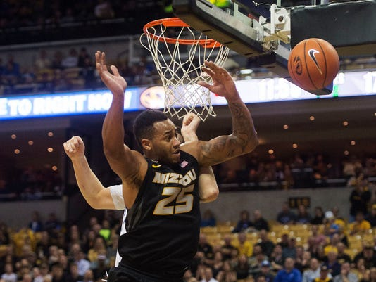 Missouri's Russell Woods (25) loses control of the ball in front of Kentucky's Isaac Humphries during the first half of an NCAA college basketball game, Tuesday, Feb. 21, 2017, in Columbia, Mo. (AP Photo/L.G. Patterson)