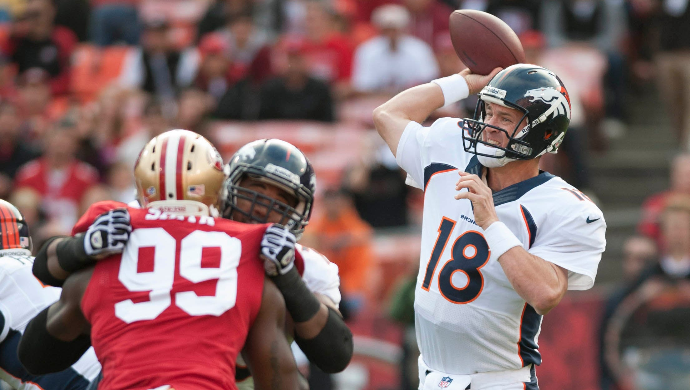 Denver Broncos quarterback Peyton Manning (18) throws a pass during the first quarter of the game against the San Francisco 49ers at Candlestick Park.