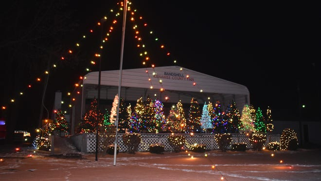 """Normally a venue for concerts and other programs during fair week, the Lenawee County Fair's Bandshell was transformed into a display of many community decorated Christmas trees during Friday and Saturday's """"Fair Fantasy Lights Drive Thru"""" event."""