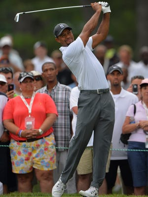 Tiger Woods hit his tee shot on the second hole during the second round of the Quicken Loans National golf tournament at Congressional Country Club. Wood is currently battling to make the cut.