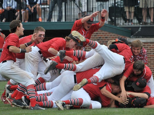 Orchard Lake St. Mary's celebrates its Division 2 baseball title last year.