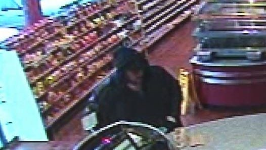 Newly released footage shows a man, right, purchasing the mystery Hot Lotto ticket.