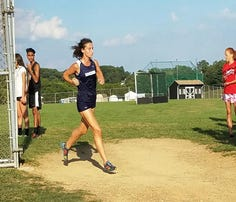 Running has helped Chambersburg junior Madison Ford, a member of the Trojans' cross country team, take control of her life.