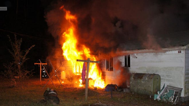 Flames sweep through a home on Camp Arrowhead Road in Angola Neck area early Monday.