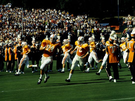 Tennessee players Dick Williams (74), Jerry Holloway
