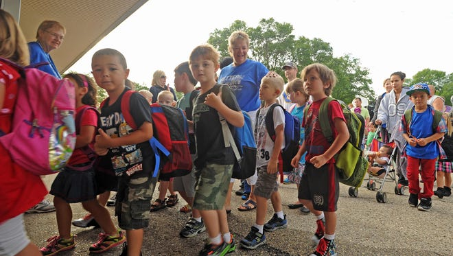 Doug Raflik/Action Reporter MediaFirst and second grade students at Roberts Elementary School file through the door after saying goodbye to parents and grandparents Monday morning on their first day of school. Tuesday officially marked the beginning of the 2014-15 school year for most students throughout Fond du Lac County. Kids shuffle into Roberts Elementary School for the first day of the '14 / '15 school year Tuesday morning. Tuesday September 2, 2014. Doug Raflik/Action Reporter Media