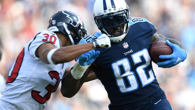 Titans tight end Delanie Walker (82) scores a touchdown defended by Texans cornerback Kevin Johnson (30) in the third quarter of a game at Nissan Stadium Sunday, Dec. 3, 2017 in Nashville, Tenn.