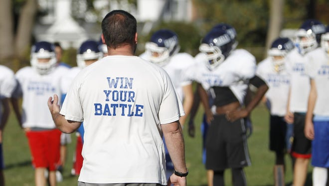 Dobbs Ferry coach Jim Moran watches his team practice during one of three bye weeks the Eagles sat through in 2015.