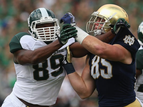 Michigan State's Shilique Calhoun, left, battles Notre Dame's Troy Niklas in 2013 in South Bend, Indiana. the Spartans lost the game, 17-13, but didn't lose again that season.