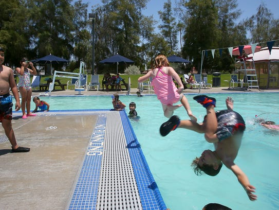 Children escape the heat by swimming at the Palm Desert