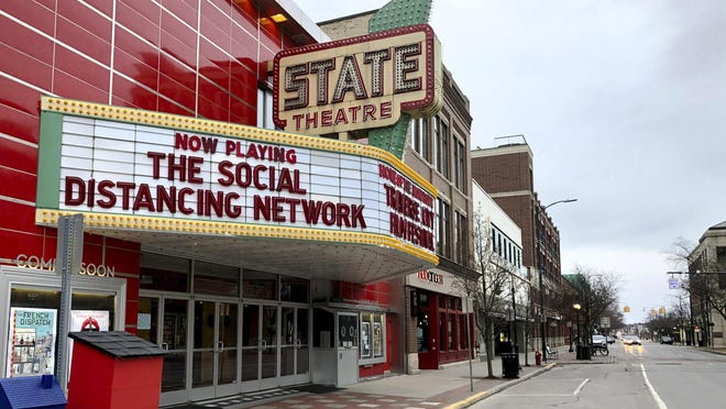 In this March 18, 2020, photo, a tongue-in-cheek message is displayed on the marquee of the State Theatre in Traverse City. Gov. Gretchen Whitmer announced Friday that Michigan movie theaters, closed since March, can reopen Oct. 9.