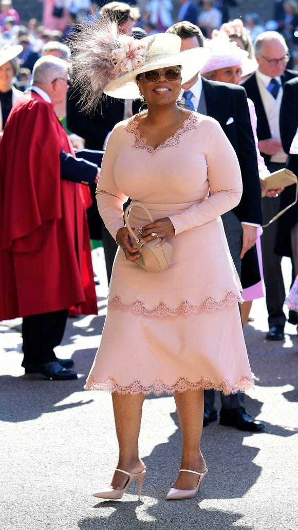 Oprah Winfrey looked beautiful at the royal wedding, pairing her pink Stella McCartney dress with a plumed hat.