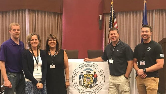 A team from Two Rivers Public School District and Two Rivers Police Department recently attended the attorney general's Summit on Public & School Safety. Pictured, from left, are Chad Bauknecht, Magee Elementary principal; Dana McLinn, Koenig Elementary School principal; Lisa Quistorf, district administrator; Craig Rysticken, Two Rivers High School principal; and Jake Glaser, school resource officer.