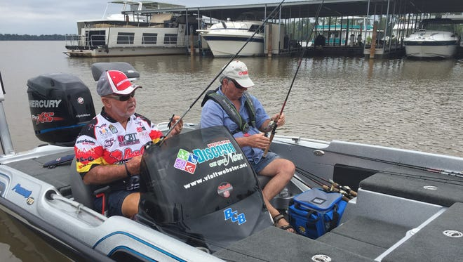 Homer Humphreys, left, and John Roberson check their rods before heading out on the Red River Monday in practice for the Bass Pro Shops Bassmaster Central Open.