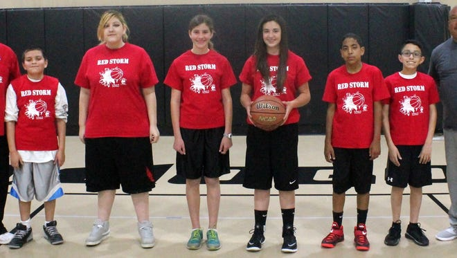 The 11-12 year old Red Storm basketball team finished 5-0 to win the Alamogordo Family Recreation Center championship. This was their second consecutive undefeated season. Head coach Alfonso Rey would like to dedicate this championship season to the late Jerry Romero. Pictured are Anna Armani, Javonni Flores, Nicholas Martinez, Dangelo Rey, Davion Smith and Dominic Thompkins along with coaches Alfonso Rey and Chino Gonzalez. Not pictured: Isaac Amaya, Kaitano Bateman, Alex Cook and Jesus Ochoa.