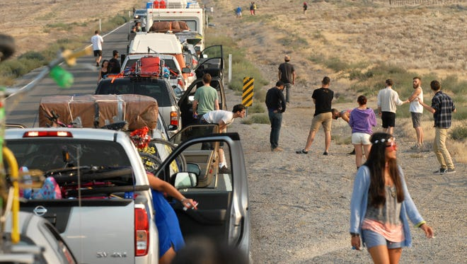 Burning Man traffic gets backed up on Hwy 447 on Aug. 26, 2013.