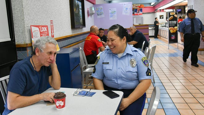 "Tamuning resident Patrick Sullivan, left, talks with Officer Susie Santos during Guam Police Department's Coffee with a Cop outreach at the Tamuning McDonald's on Jan. 25, 2017. Sullivan said he was glad to see police be in touch with the community, and that it was ""reminiscent of what Gov. (Ricky) Bordallo did years ago."""