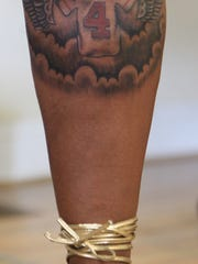 Shelia Shields, Anton Kirby's aunt, has had a tattoo of his football jersey done on her calf.