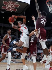 Mississippi guard Blake Hinson (0) pulls Mississippi State guard Quinndary Weatherspoon (11) and forward Abdul Ado (24) out as he attempts a shot in the second half of an NCAA college basketball game, Saturday, Jan. 12, 2019 in Starkville, Miss. Mississippi won 81-77. (AP Photo/Rogelio V. Solis)