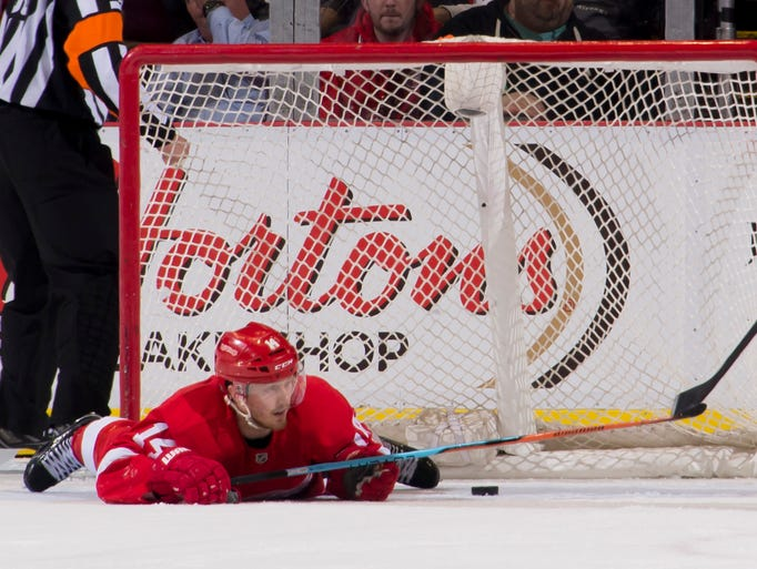 Red Wings center Gustav Nyquist lays on the ice after