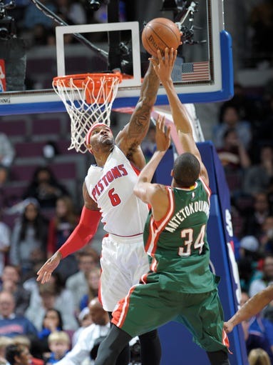 The Pistons' Josh Smith blocks the shot of the Bucks'