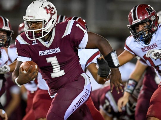 Henderson County quarterback Skip Patterson (1) runs one of many quarterback as Henderson County plays district rival McCracken County at Colonel Field Friday, October 6, 2017.