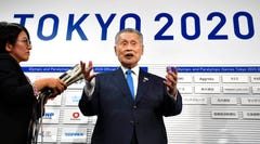 Yoshiro Mori, president of the 2020 Tokyo Olympics organizing committee, speaks to the media in Tokyo, Thursday, Oct. 17, 2019. Sapporo officials are thrilled with a proposal to move next year's Tokyo Olympic marathons to the northern Japanese city to avoid the summer heat in the city.(Kyodo News via AP)