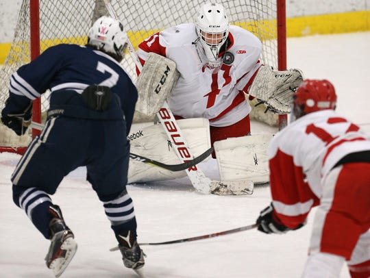 Penfield goalie Brennan Lee makes the stop on the point