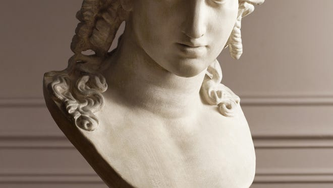 This photo provided by Restoration Hardware shows a bust of Ariadne cast from plaster and hand rubbed to give it an aged look as an elegant objet d?art from the neoclassical era. Architectural fragments, Italian etchings of Greco-Roman architecture, and reproduction plaster busts are part of a large range of decorative elements that evoke neoclassical décor at Restoration Hardware. (AP Photo/Restoration Hardware)