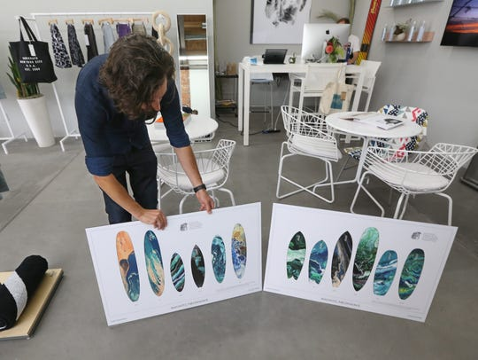 Owner Fred Rainaldi goes over some of the surf boards