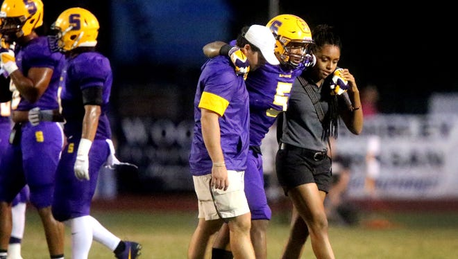 Smyrna's Casey Perkins (5) is helped off the field after an injury early in the game against Independence, on Friday, Sept. 9, 2016, at Smyrna. According to the Smyrna football program Casey will be out for the season.