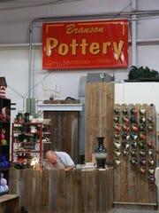 Potter Gary Mortensen works on a mug at The Branson Craft Mall.