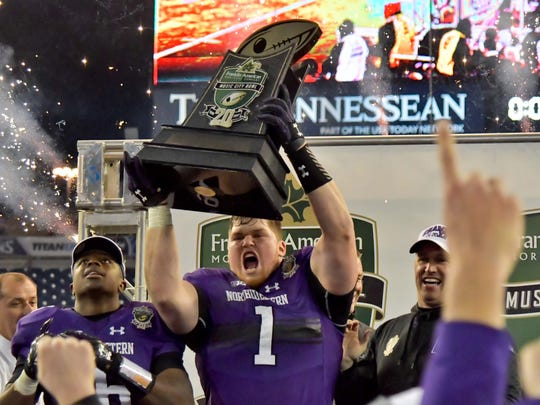 Defensive lineman Tyler Lancaster (1) and Northwestern celebrate after beating Kentucky to win the Music City Bowl in Nashville. Northwestern prevailed 24-23 for its first consecutive bowl victories in school history.