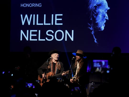 Willie Nelson, left, and his son Lukas Nelson perform as the Recording Academy's Producers and Engineers Wing honored Willie Nelson Feb. 6 in Los Angeles.