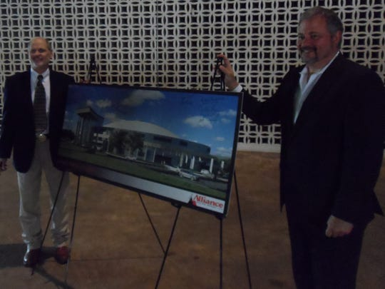 Rapides Parish Coliseum Authority Chairman Jimbo Thiels (left) and Bill Tudor of Alliance Design Group stand next to a rendering of what the exterior of the Coliseum will look like following a $22.9 million renovation.