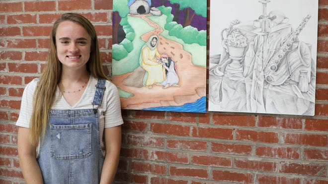 "Jack White Character Scholarship recipient Haleigh Clevenger is pictured with her painting ""Rabboni"" and graphite piece ""Miscellany."""