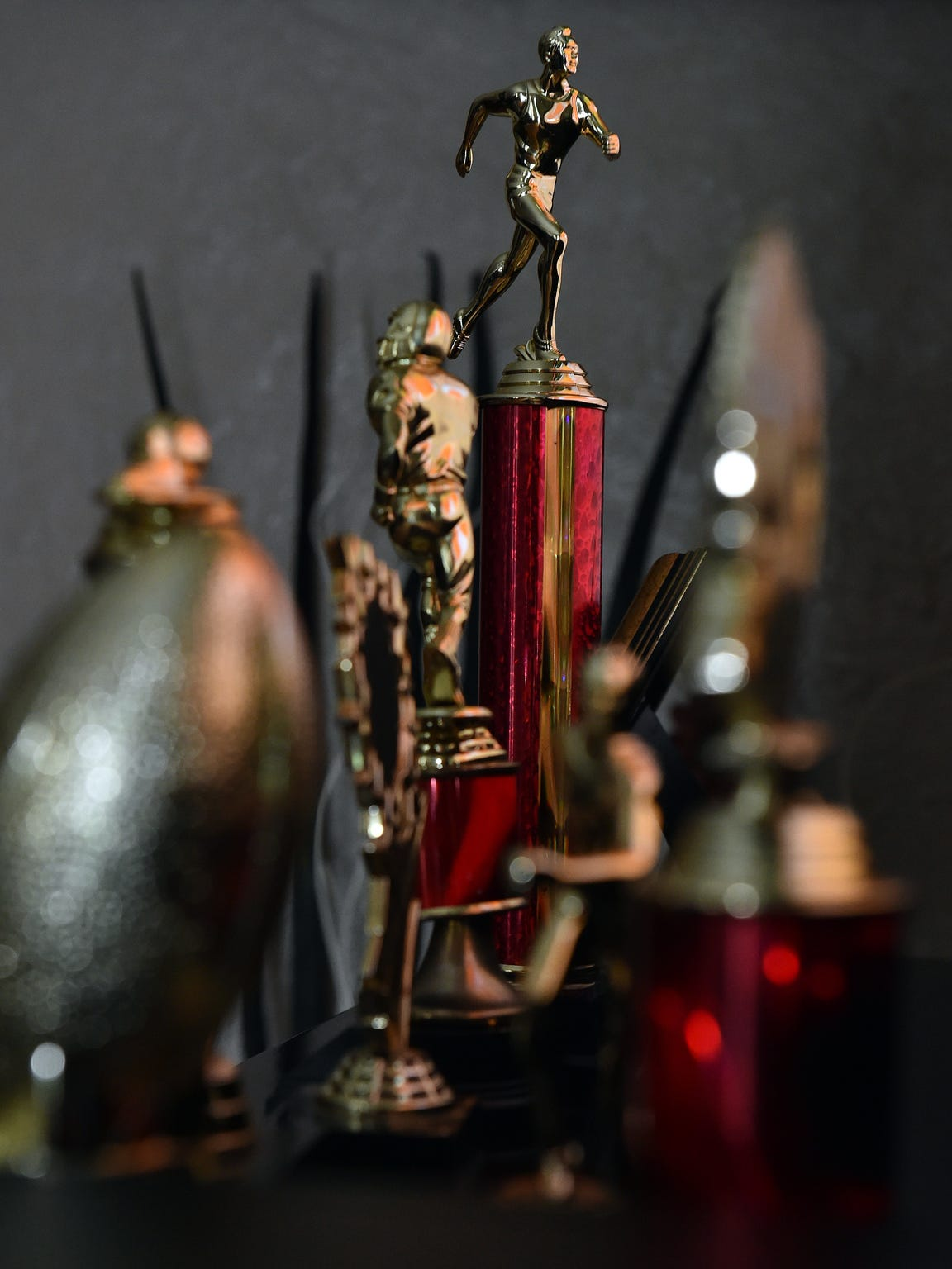 A row of Melvin Mangum Jr.'s trophies at his mother's