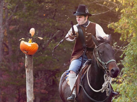 A rider practices taking a little off the top for Saturday's pumpkin-slashing event as part of Sleepy Hollow at Tunnel Mill.