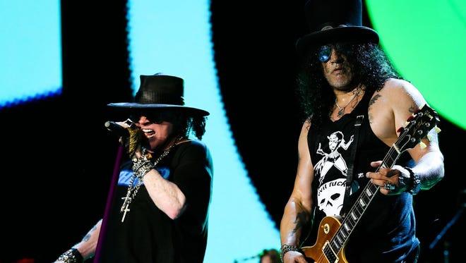 Axl Rose and Slash perform during Guns N' Roses' concert at Nissan Stadium Saturday, July 9, in Nashville.