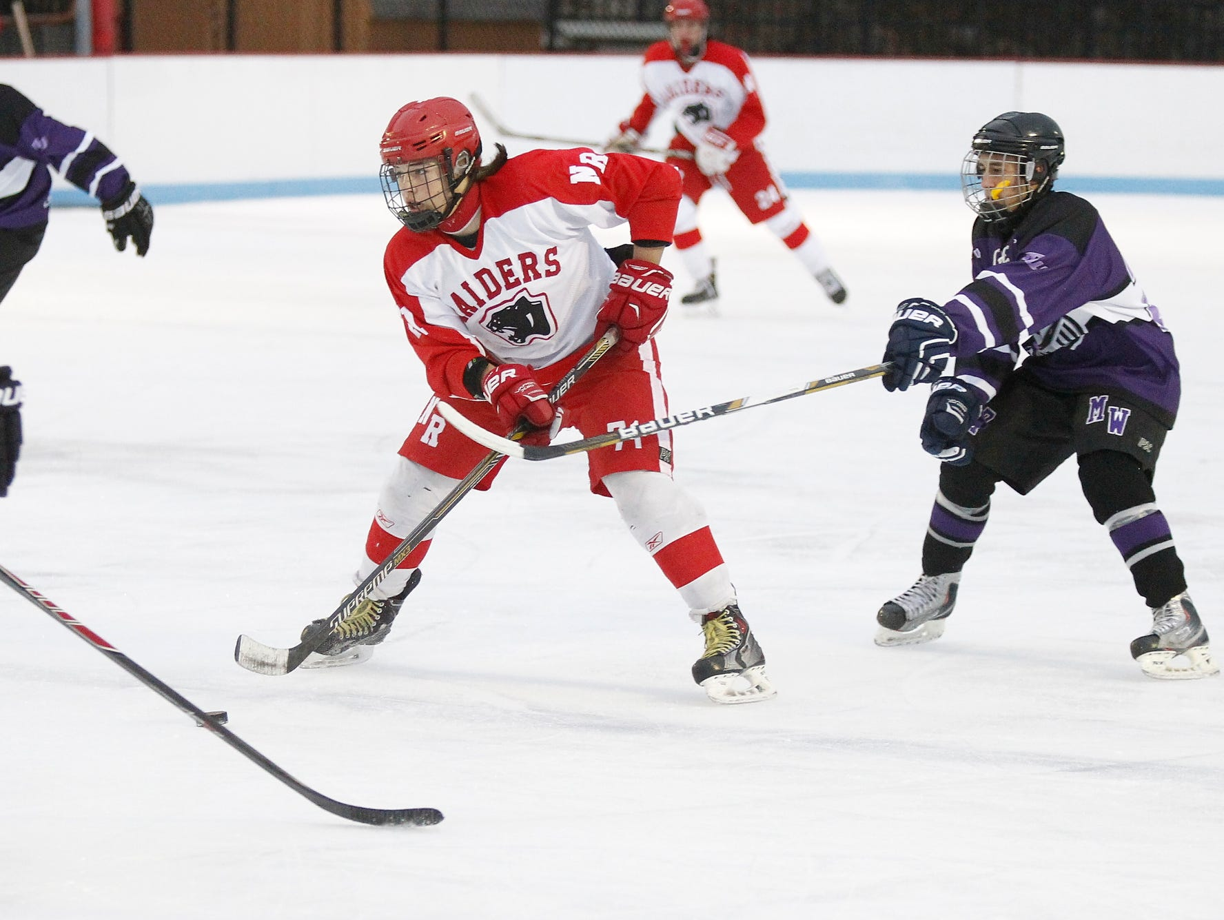 North Rockland's Jack Guerra (71) works the puck through the Monroe-Woodbury defense during the first annual Winter Classic Hockey Tournament at the Bear Mountain Ice Rink in Tompkins Cove on Friday, Dec. 18, 2015.