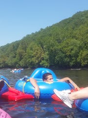 Chris Meyer (left to right), Alberto Sanchez and Andrea Milano, who attended the 13weeks river tubing trip with the crew.