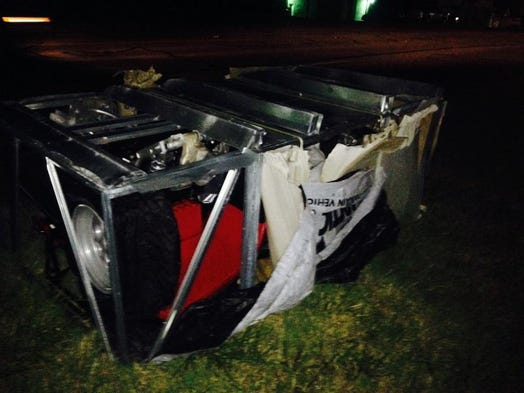 Pictured is the crate carrying the new four-wheeler that police believe Rory Allen Gregory stole, which led to Saturday night's police pursuit and crash.