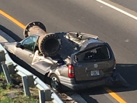 A pipe fell on top of a van traveling onto State Road