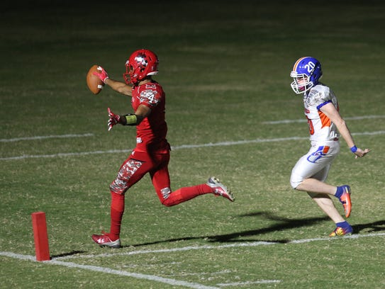 Game action between North Fort Myers High School and
