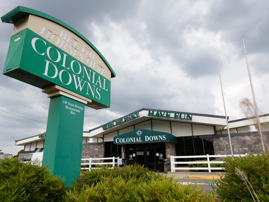 A Colonial Downs Off Track Betting parlor in Richmond, Va., Tuesday, June 3, 2014.   The state's only race track  and it's OTB parlors are prohibited by state law from accepting any wagers on thoroughbred racing until it comes to an agreement with horse owners and trainers about the number of racing days it will hold this year.  (AP Photo/Steve Helber)