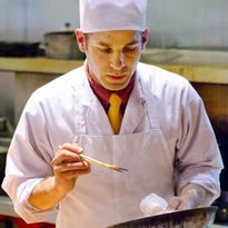 Chef and owner Chris Russo works in the kitchen of San Sai restaurant in Burlington in May, 2012.