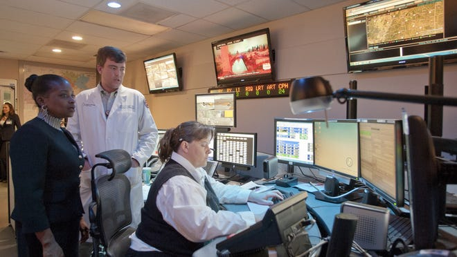 The impact of UMMC's MED-COM drew the attention of FCC Commissioner Mignon Clyburn, left, who toured the facility inDecember 2014 with Dr. Damon Darsey. The commissioner was oncampus to see how UMMC utilizes technology to provide efficient care to patients.