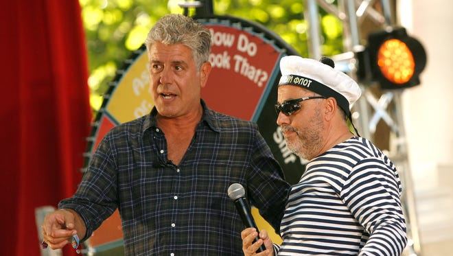 TV personality Anthony Bourdain (L) and Zamir Gotta speak at the Great Googa Mooga 2012 at Prospect Park on May 20, 2012 in the Brooklyn borough of New York City.