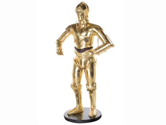 A life size model of C-3PO, belonging to the late actress